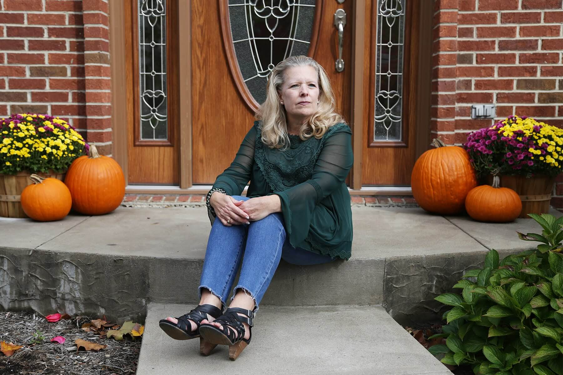 Tina Flowers sits outside her home in Hampton Township in October 2020. (Photo by Ryan Loew/PublicSource)