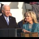 Dr. Jill Biden looks on as President Joe Biden takes his oath of office on Wednesday, January 20, 2021, minutes before noon.