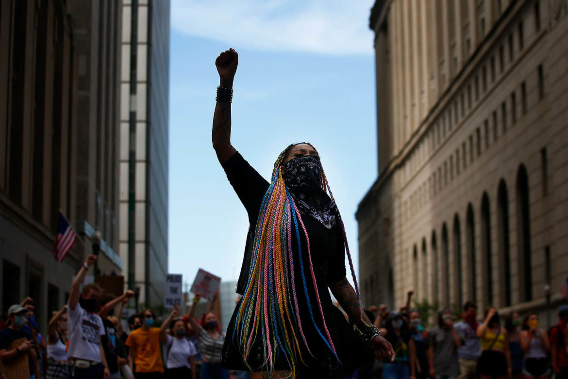 Toy Slaughter raises a fist during a Black Lives Matter march in Downtown Pittsburgh on Tue., June 16, 2020. (Photo by Jared Wickerham/Pittsburgh City Paper)