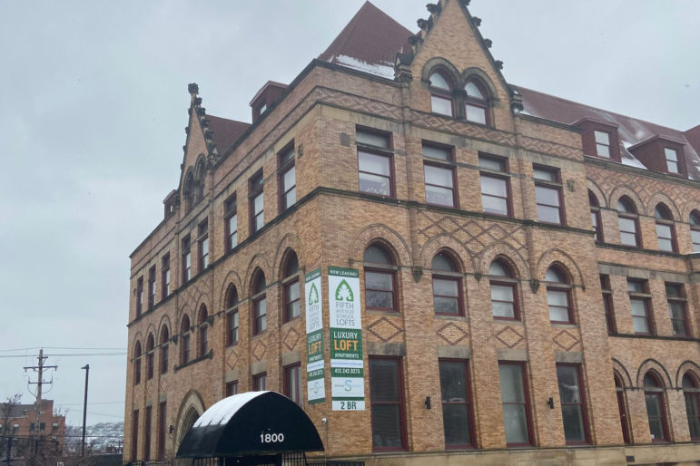 The former Fifth Avenue High School, in the Bluff neighborhood of the City of Pittsburgh, is being transformed into loft apartments. It's another entry in a growing rental housing market that the city is trying to regulate through registration. (Photo by Rich Lord/PublicSource)