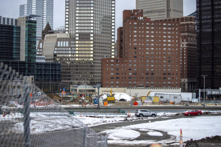 View of Downtown Pittsburgh and part of the site of the former Civic Arena, where the Penguins are leading a redevelopment effort, in February 2021. (Photo by Jay Manning/PublicSource)