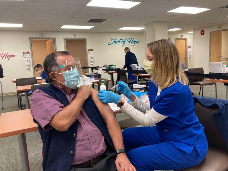 Cesar Augusto Amaya Garzon, 73, receiving a vaccine shot. (Photo courtesy of Casa San José)