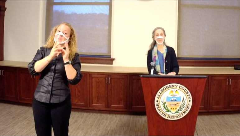Allegheny County Health Department Director Dr. Debra Bogen (right) briefs the public and media via Facebook on Feb. 24, 2021, as a sign language interpreter accompanies. (Screenshot)