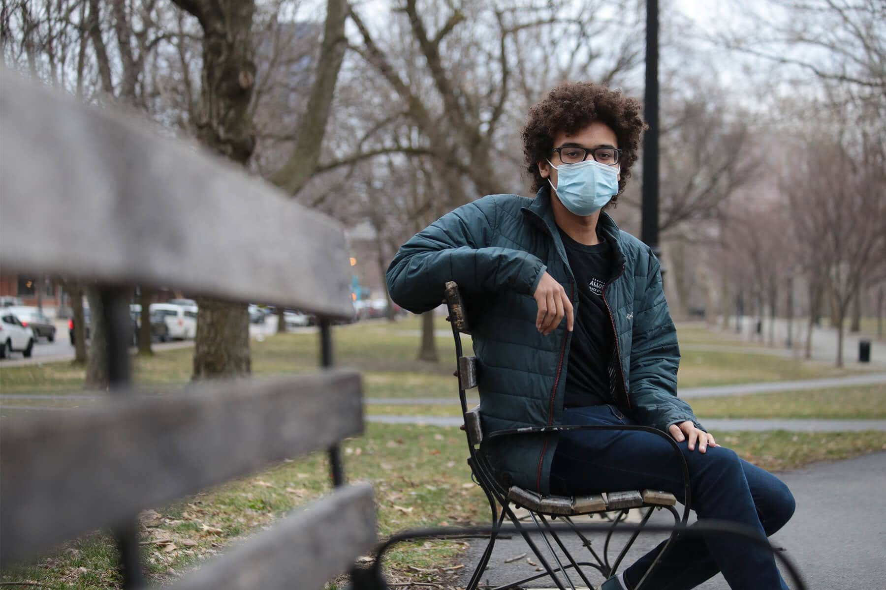 Dakota Castro-Jarrett, 17, is a senior at Taylor Allderdice High School. Here he is photographed at Allegheny Commons park, which is near his home in East Allegheny. (Photo by Ryan Loew/PublicSource)