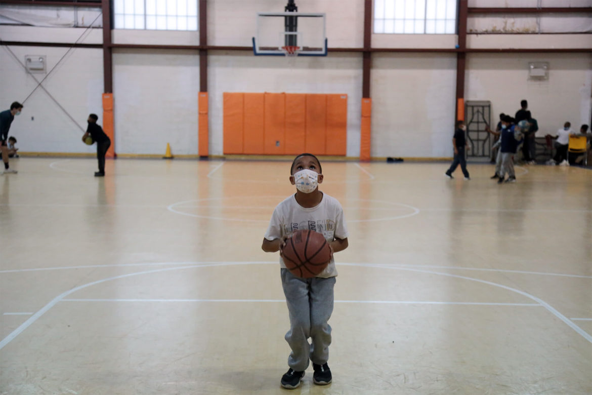 Deonjre Jackson, 8, plays basketball in the gym at the Boys & Girls Clubs of Western Pennsylvania Duquesne clubhouse on March 11. (Photo by Ryan Loew/PublicSource)