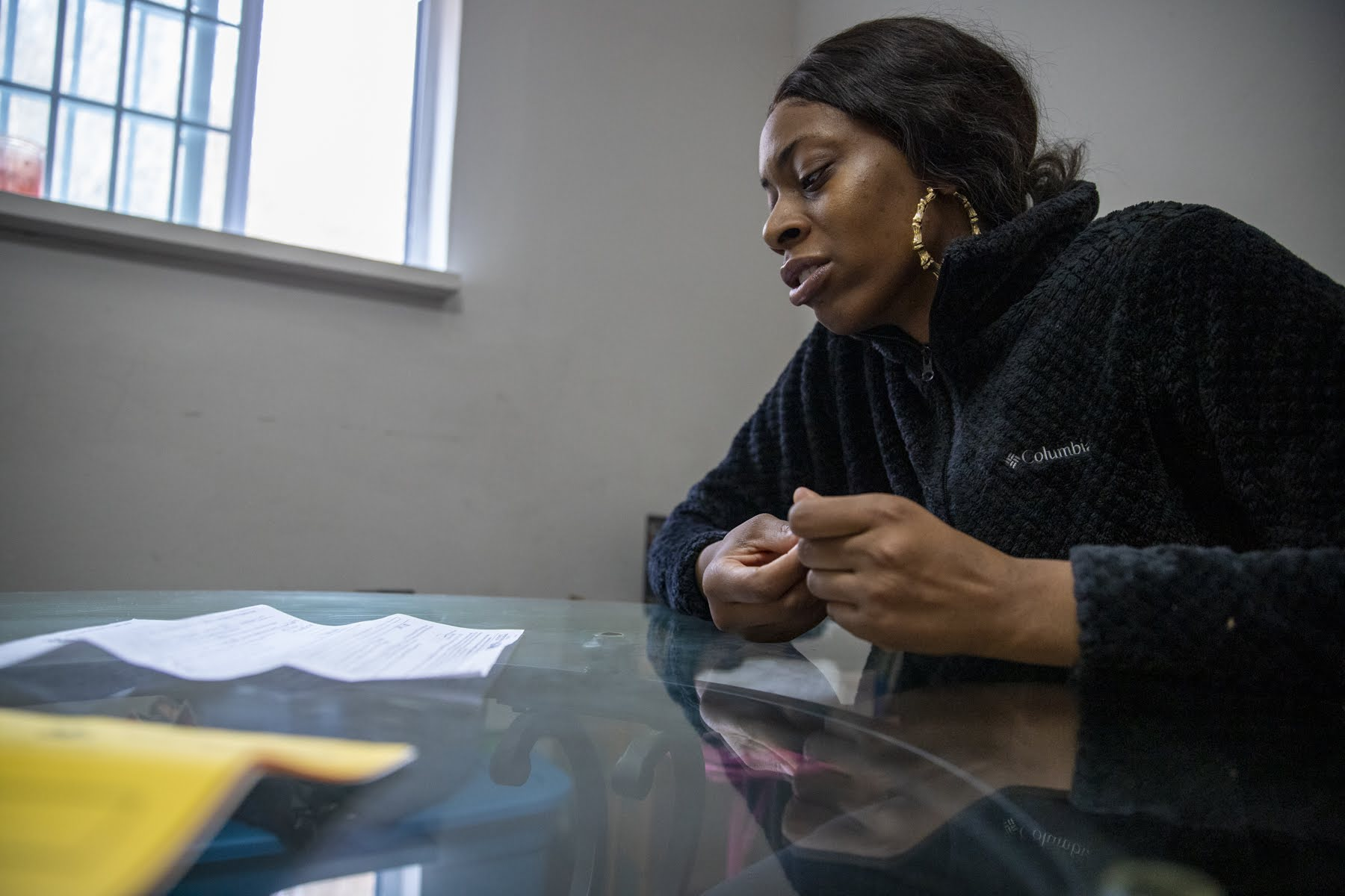 Shanese Nelson looking at the paperwork filed by her landlord at her old home in Penn Hills