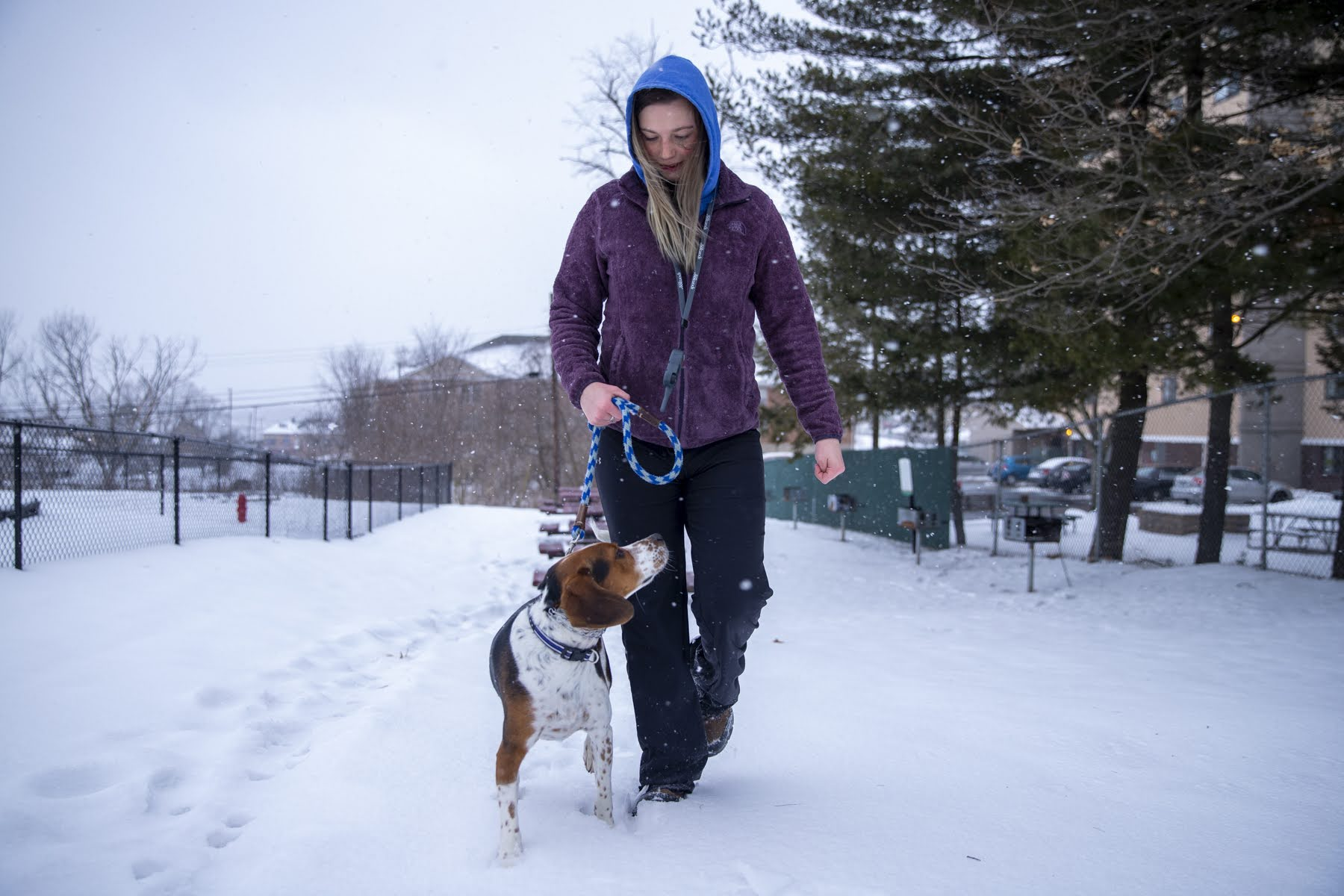 Rose Mizak and her dog Bear walking in The Alden South Hills apartment complex