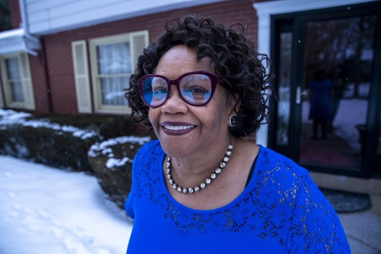 Rev. Brenda J. Gregg stands in front of her house on a snowy day.
