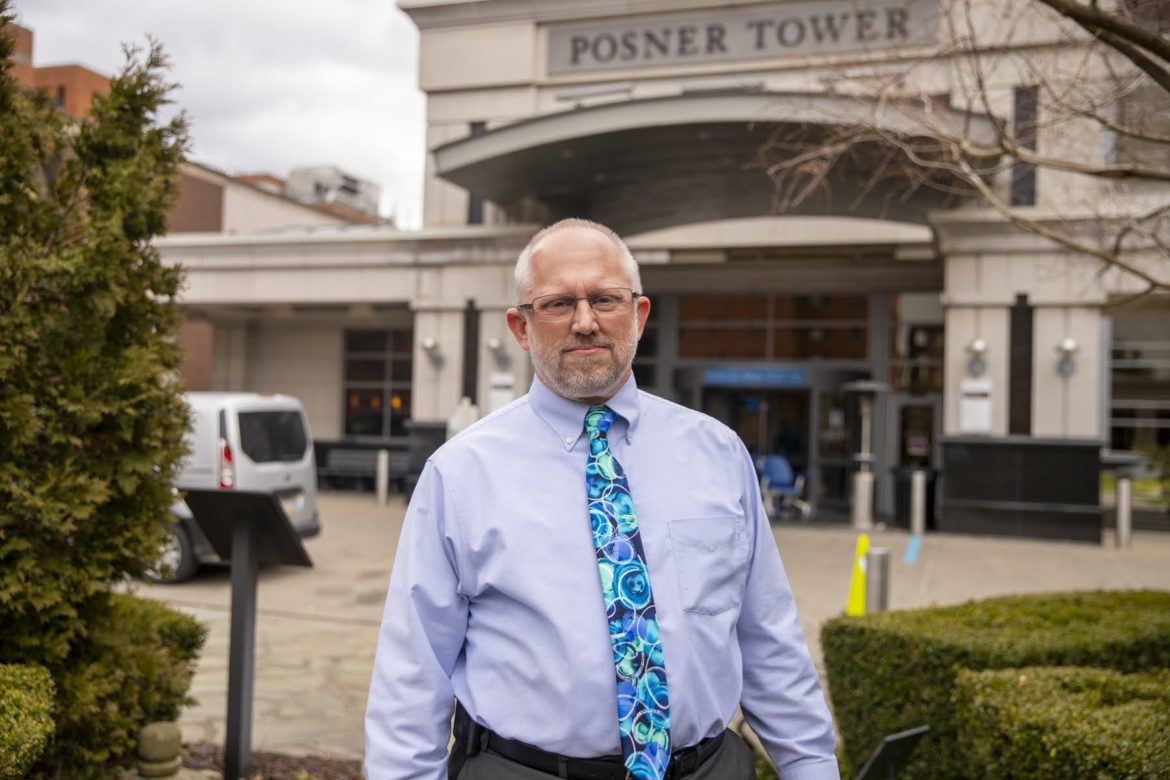 Rev. Andrew Shaffer stands outside Posner Tower, an entrance to UPMC Shadyside hospital