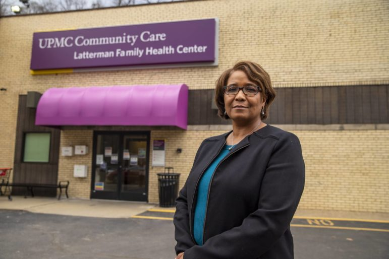 Dr. Tracey Conti stands outside of UPMC Community Care