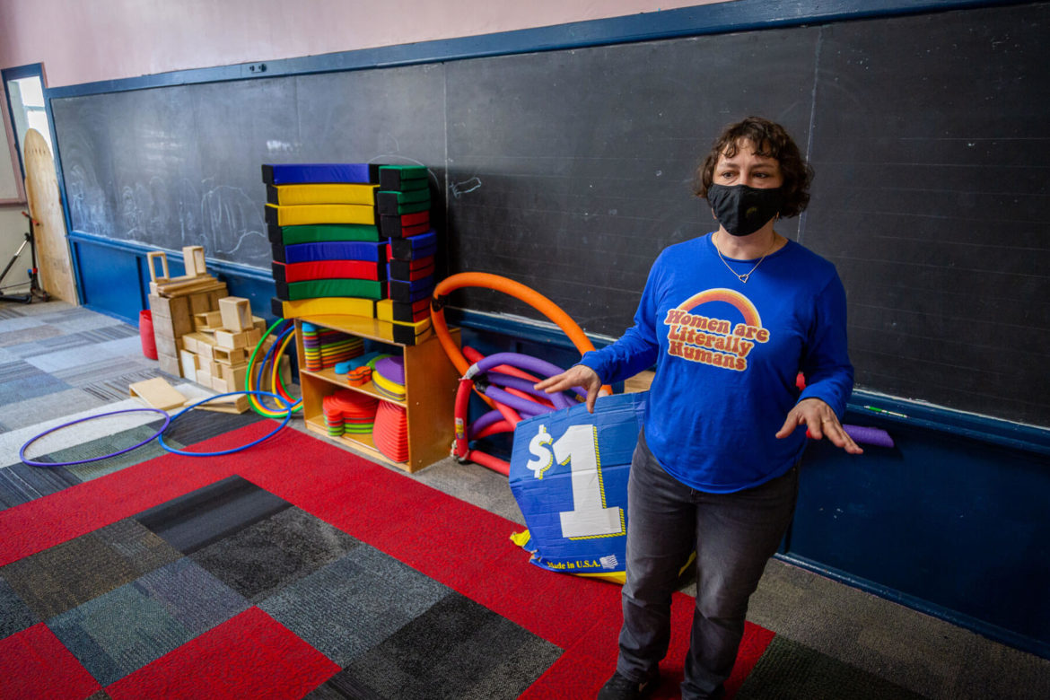 Instructor Maggie Dogdanich explaining showing the play room at the Three Rivers Village School in Hazelwood. (Photo by Nick Childers/PublicSource)