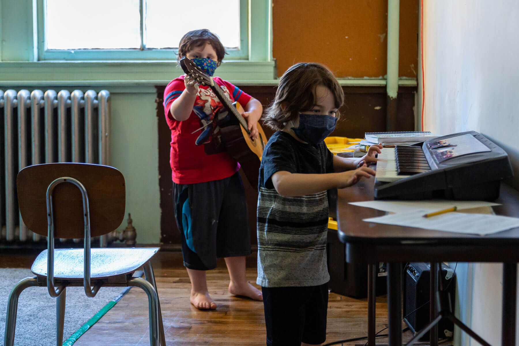 Students playing instruments in the music room at the Three Rivers Village School in Hazelwood. (Photo by Nick Childers/PublicSource)