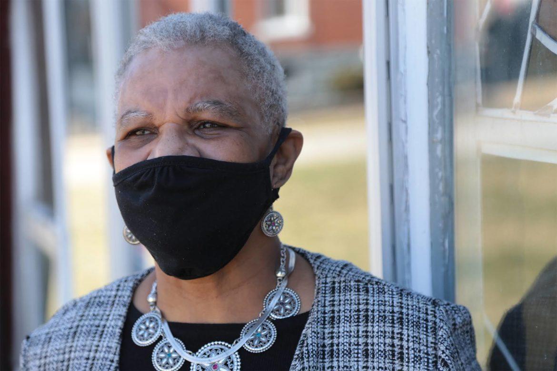 A headshot of Rev. Prudence L. Harris, wearing a mask