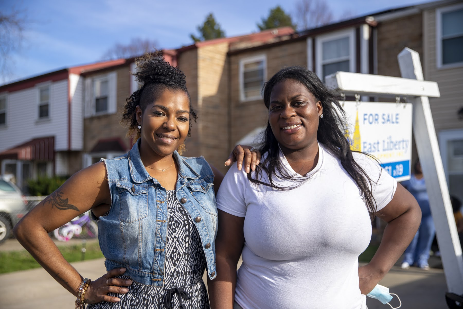 Mary Hester (left), of LifeVenture Real Estate Services, and Brettney Duck, Catapult Greater Pittsburgh's director of homeownership, work together to prepare East Liberty residents to buy townhouses, and then walk them through the process. (Photo by Jay Manning/PublicSource)