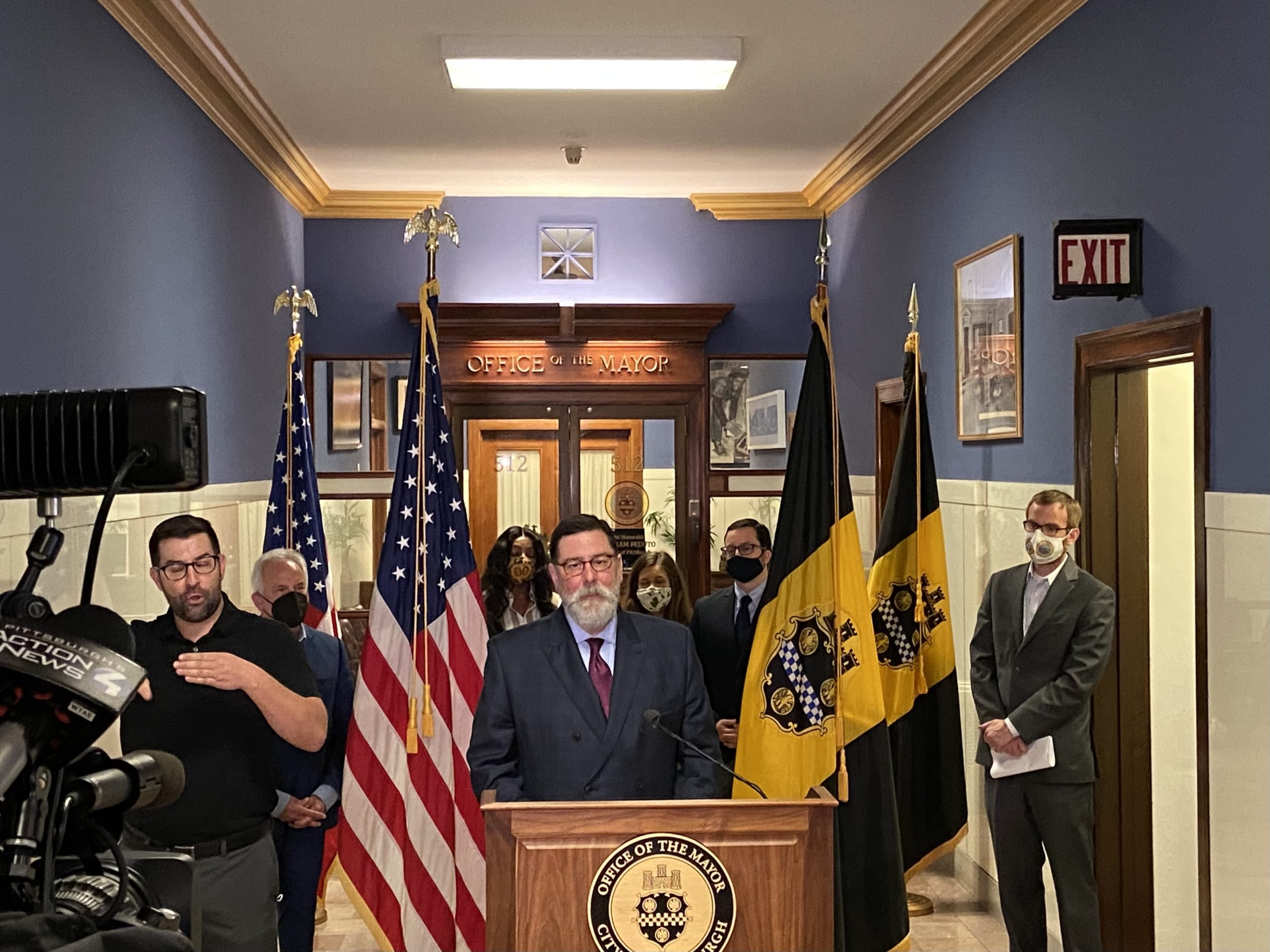 Pittsburgh Mayor Bill Peduto, with Chief of Staff Dan Gilman to his left, announces the OnePGH commitments on April 29, 2021, in the City-County Building. (Photo by Rich Lord/PublicSource)