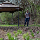 Betty Foster-Pinkley stands in front of a rain garden that Upstream, an environmental nonprofit, installed in her backyard. (Photo by Quinn Glabicki/PublicSource)