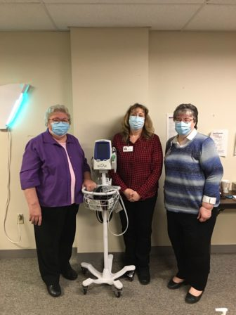 Pittsburgh Mercy Parish Nurse and Health Ministry Program team members Sister Rebecca Nolan, Amy Armanious and Kathy Conrad (L to R) in their home clinic.