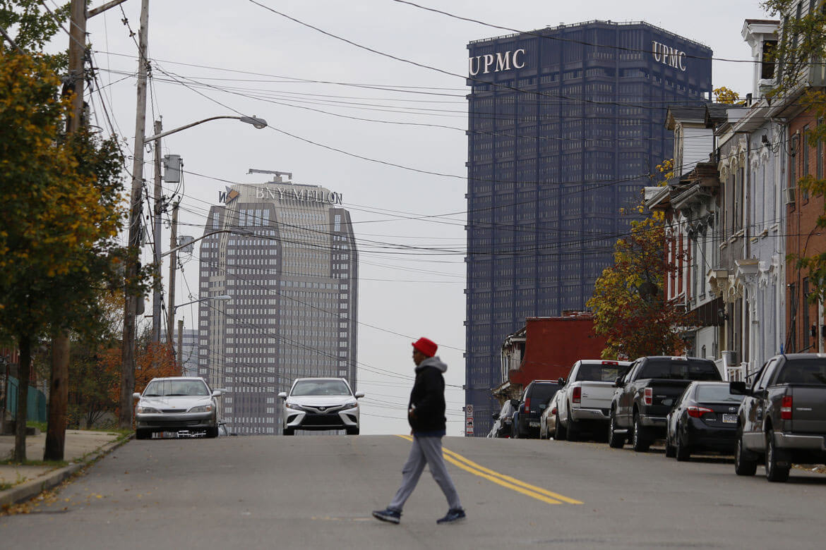 UPMC's logo atop the U.S. Steel Tower, Downtown, as seen from Webster Avenue in the Hill District. (Photo by Ryan Loew/PublicSource)