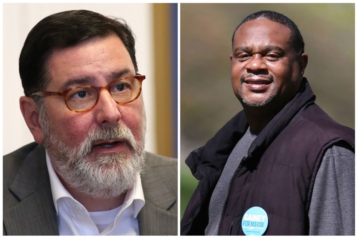 Headshot photos of Mayor Bill Peduto and state Rep. Ed Gainey. Peduto wears glasses and a gray blazer. Gainey wears a black vest and gray shirt.