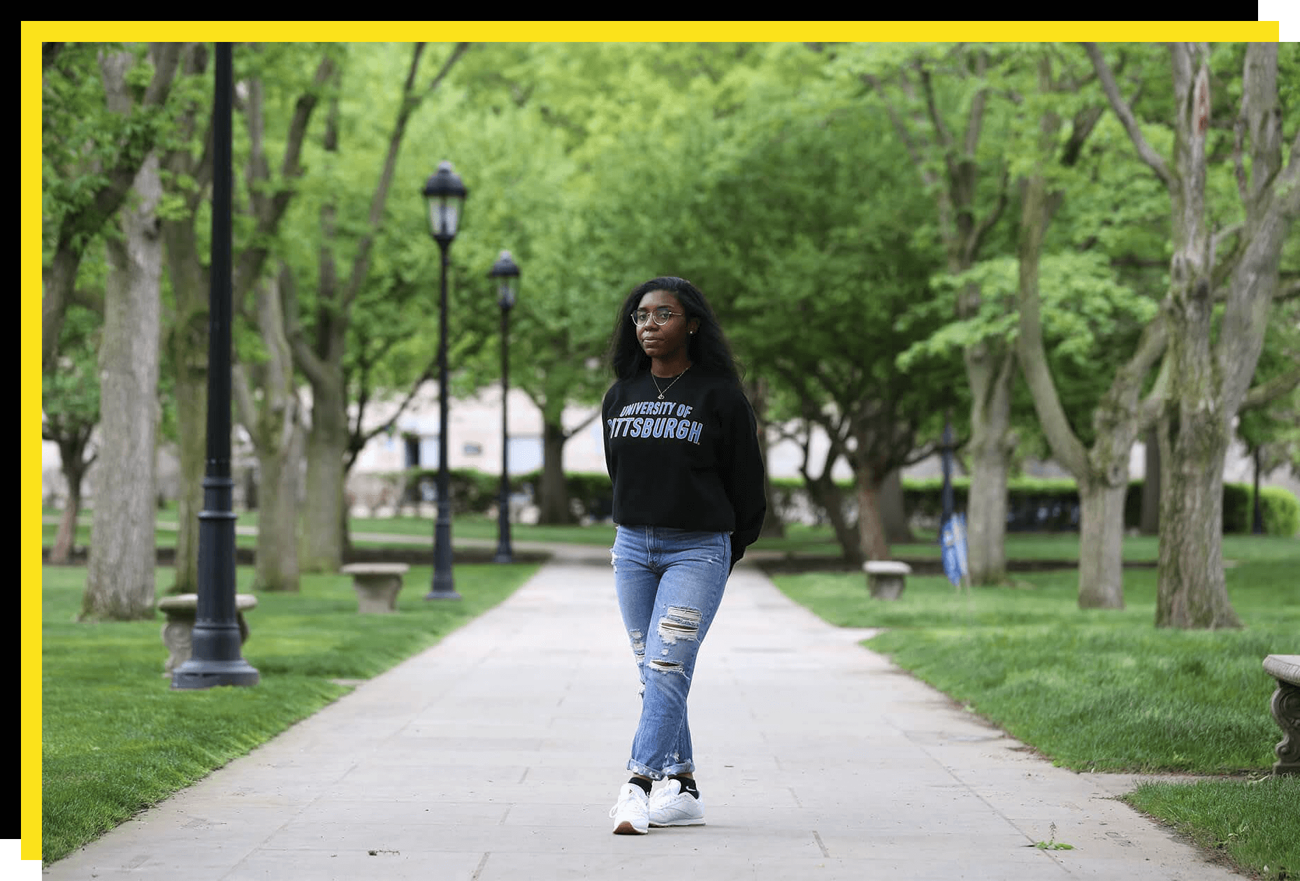Morgan Ottley, president of the Black Acton Society at University of Pittsburgh, standing on campus in a Pitt sweatshirt.