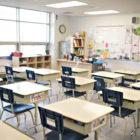 Empty classroom with empty desks