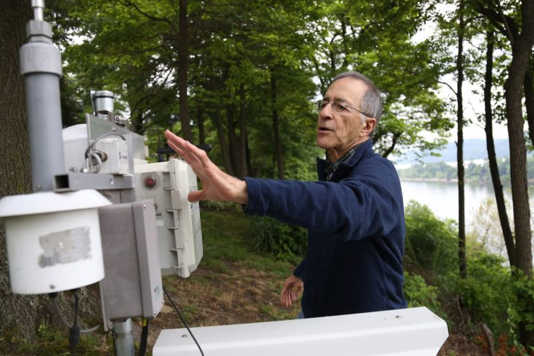 Angelo Taranto, secretary/treasurer of the group Allegheny County Clean Air Now, points out air monitors stationed in Emsworth, across the Ohio River from Metalico, a metal recycling facility on Neville Island. (Photo by Ryan Loew/PublicSource)