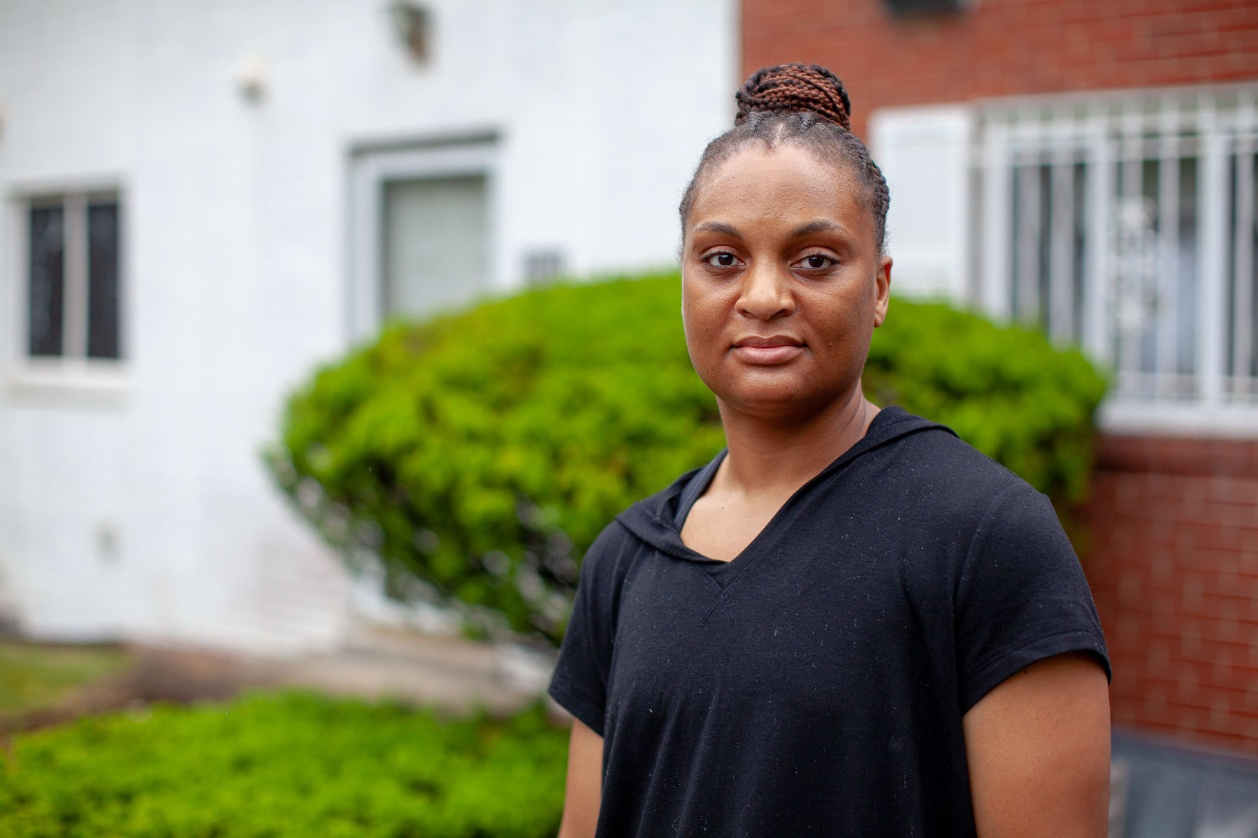 LynnDee Howell, who has lived on Park Hill Drive since she was 7, understands the worries of residents who fear gentrification, but has faith in the team that has emerged to restore the townhouses. (Photo by Quinn Glabicki/PublicSource)