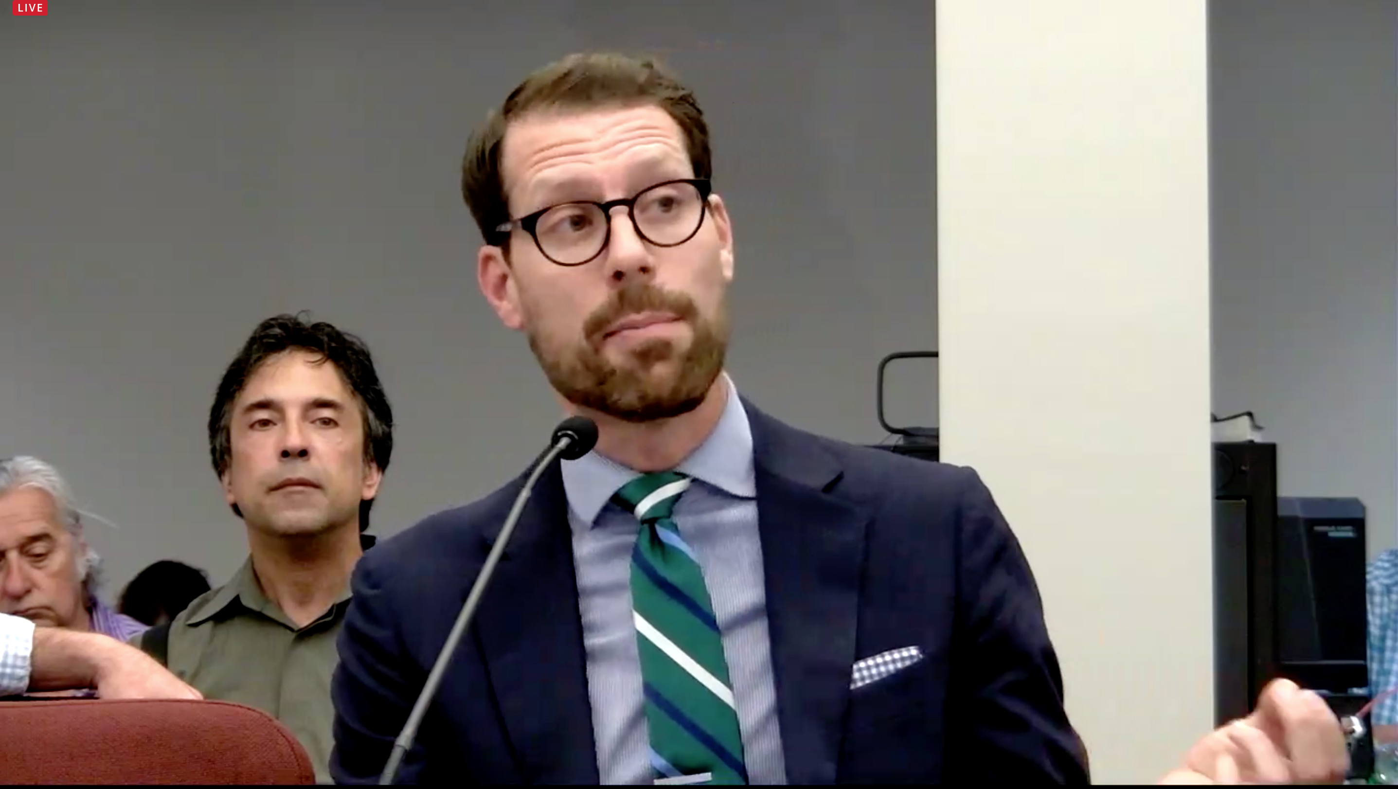 Allegheny County Economic Development Director Lance Chimka said a new fee to cover the cost of demolishing blighted buildings has raised $2.1 million, and he has $7.6 million in applications for the funds, at a June 3, 2021 hearing held by Republican state legislators in Brackenridge. (Screenshot)