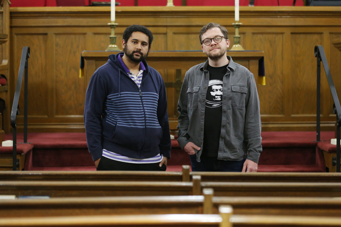 Pastors Gavin Walton and Mike Holohan stand in the sanctuary of Grace Memorial Presbyterian Church.