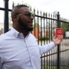 """State Rep. Austin Davis, D-McKeesport, stands in front of Hi View Gardens, an affordable housing complex purchased in 2018 by PNC Bank. """"They need to address the safety concerns immediately,"""" said Davis. """"After reading your story, my initial question is: Is it safe for the people who live here to live here?"""" (Photo by Ryan Loew/PublicSource)"""