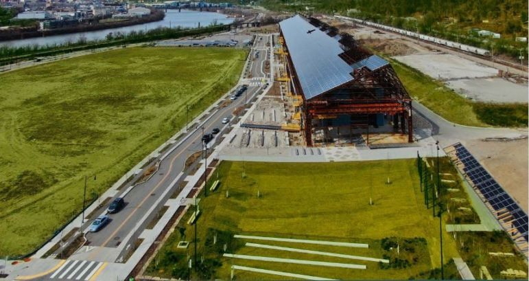 A rendering of the Mill 19 complex, on the Hazelwood Green site, as it would look after completion of the development beneath its vast solar array, presented to the City Planning Commission on July 13, 2021.