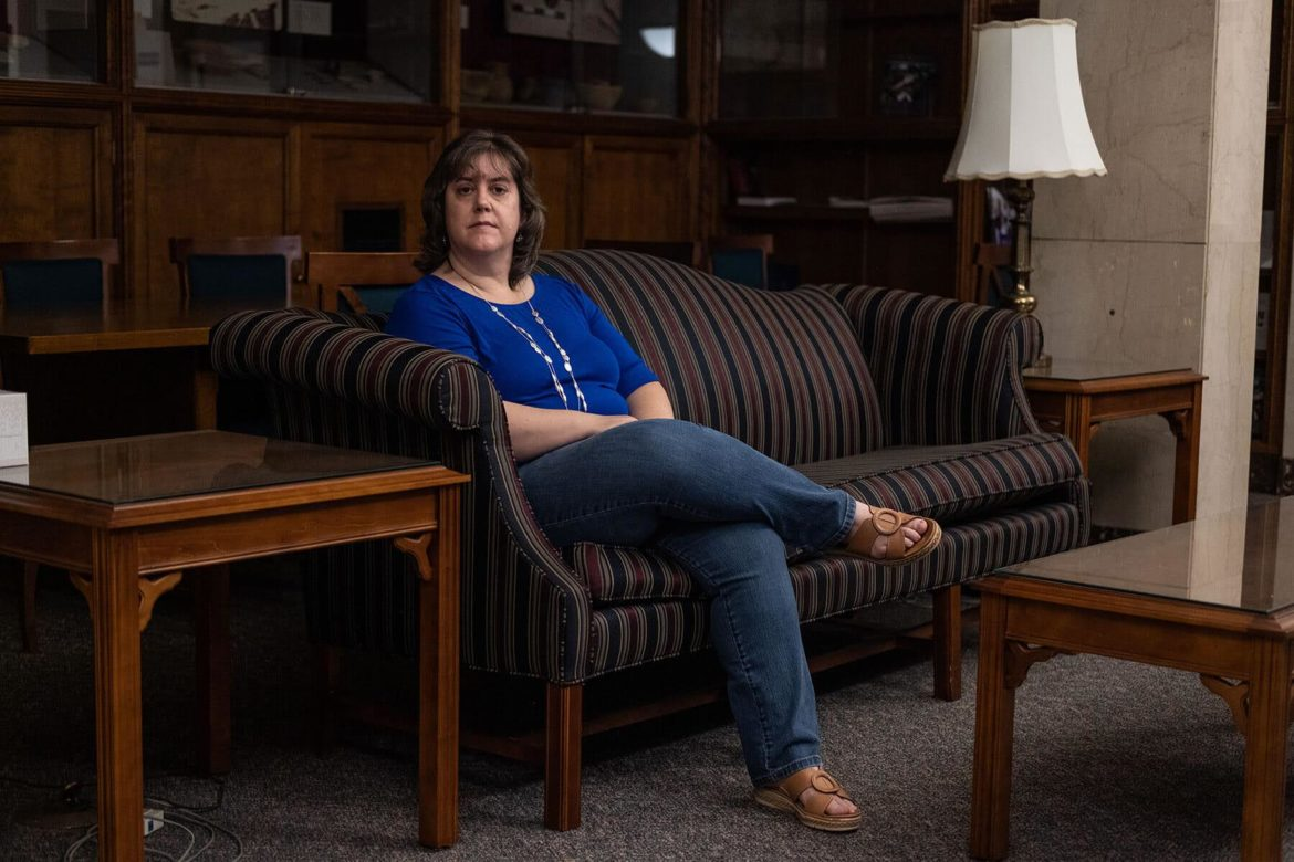 Rev. Leanna K. Fuller, associate professor of pastoral care, sits on a sofa in her office at Pittsburgh Theological Seminary.