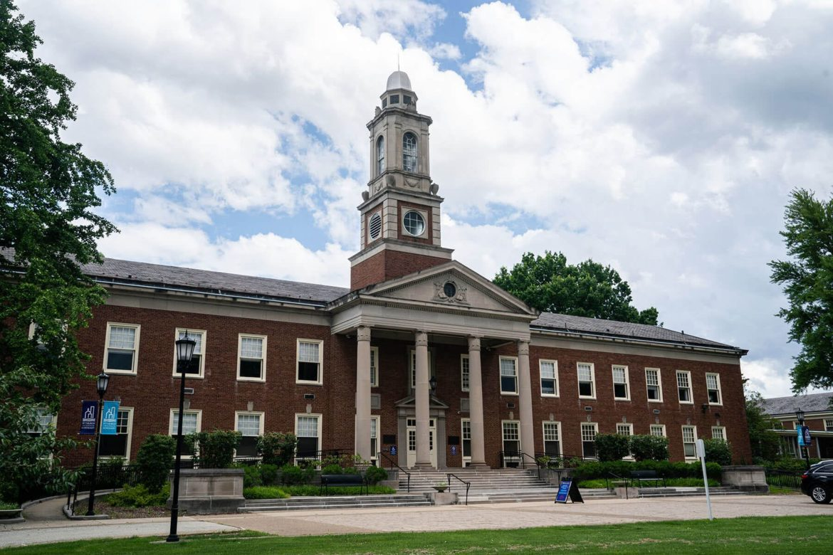 George A. Long Hall, a long red-brick building with pillars and a clock tower, at Pittsburgh Theological Seminary