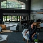 Pastor Jeff Leake sits in the spacious lobby of the Allison Park campus of Allison Park Church.