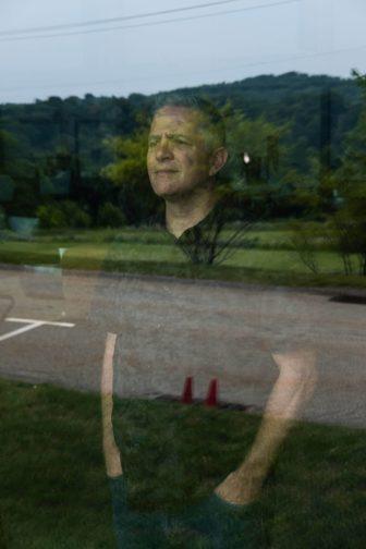 Rev. Jeff Leake looks out a window.