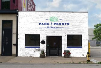 """A rendering shows a white storefront with """"Pane è Pronto, by DiAnoia's Eatery"""" spelled out in blue lettering."""