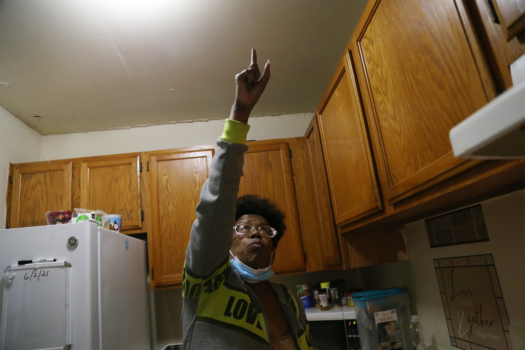 Barbara Brown, a retiree who moved to Hi View in 2018, points to a spot in the kitchen of her Hi View Gardens apartment where water comes in during rainstorms. (Photo by Ryan Loew/PublicSource)