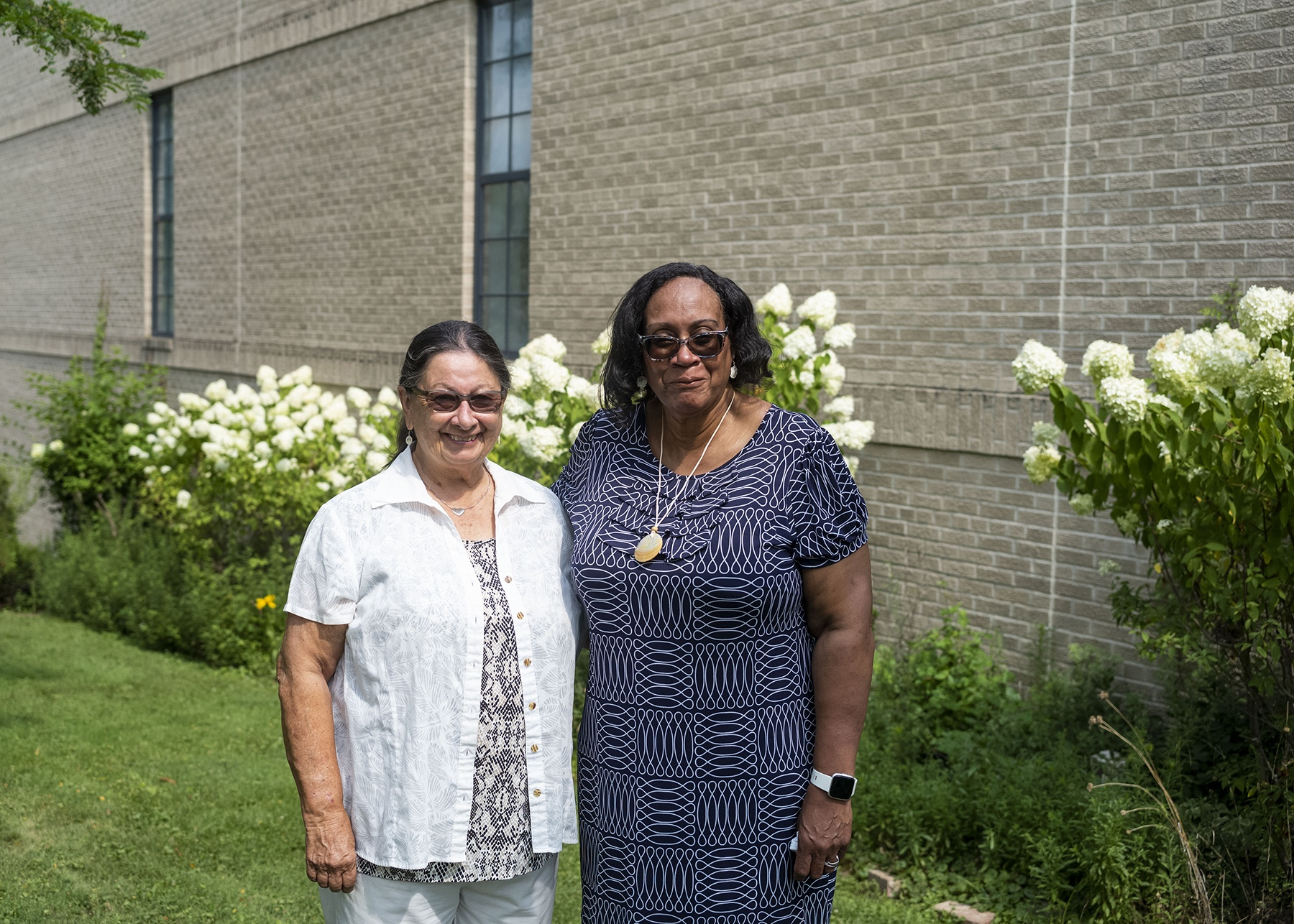 Sharon Currie, right, and Joyce Rothermel, left, stand for a photo outdoors.