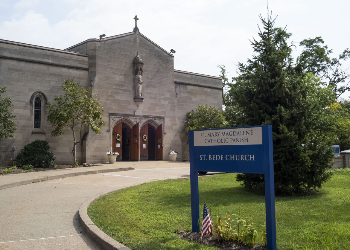 The front entrance to St. Bede Church in Point Breeze features large wooden doors and a circle drive.