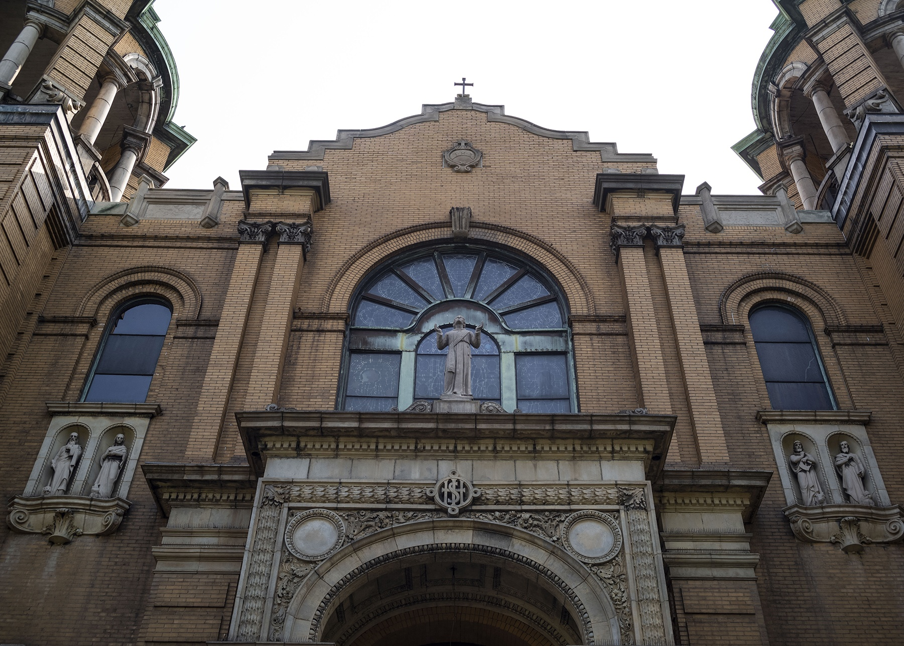 A robed statue keeps watch over the entrance to St. Stephen Catholic Church.
