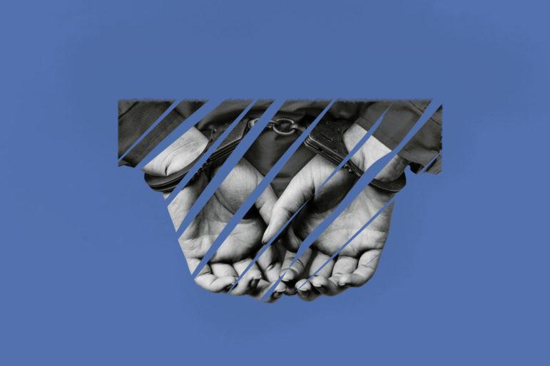 Photo illustration of handcuffed hands.