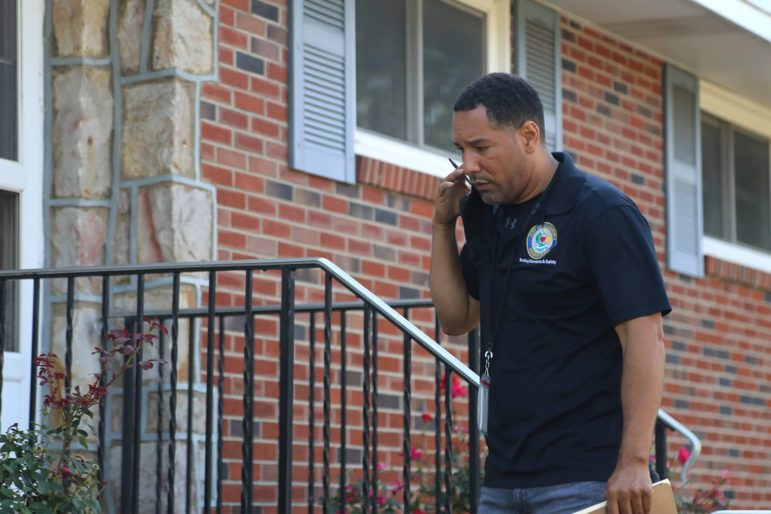 Allentown Housing Inspector Modesto Medina approaches a house in that city's southern neighborhoods in advance of an inspection. Medina schedules one inspection per hour, and this time he found a cracked window, an exposed electrical supply line, a cracked electrical outlet and a handful of other safety issues. (Photo by Rich Lord/PublicSource)