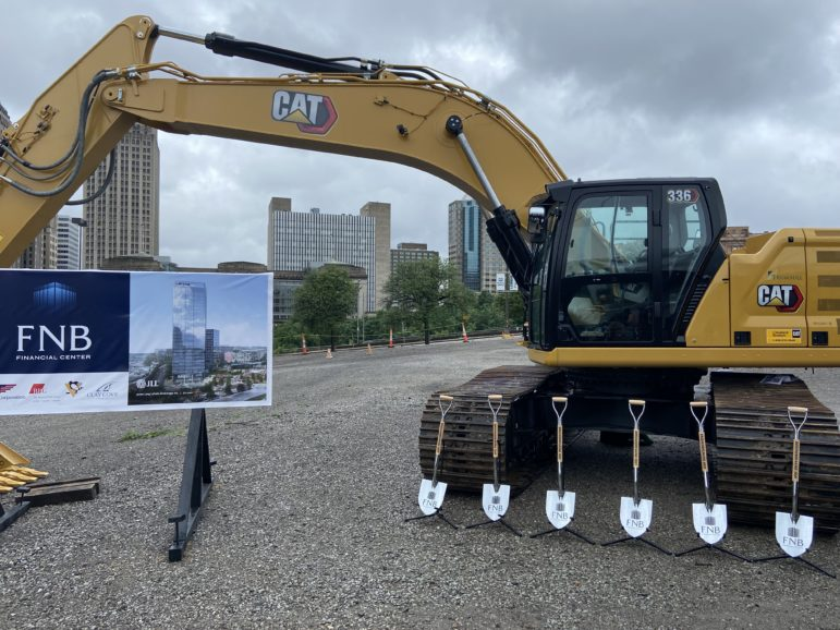An excavator sits on the Lower Hill District site slated for the FNB Financial Center, at the Sept. 1, 2021 ceremonial groundbreaking for the site. (Photo by Rich Lord/PublicSource)