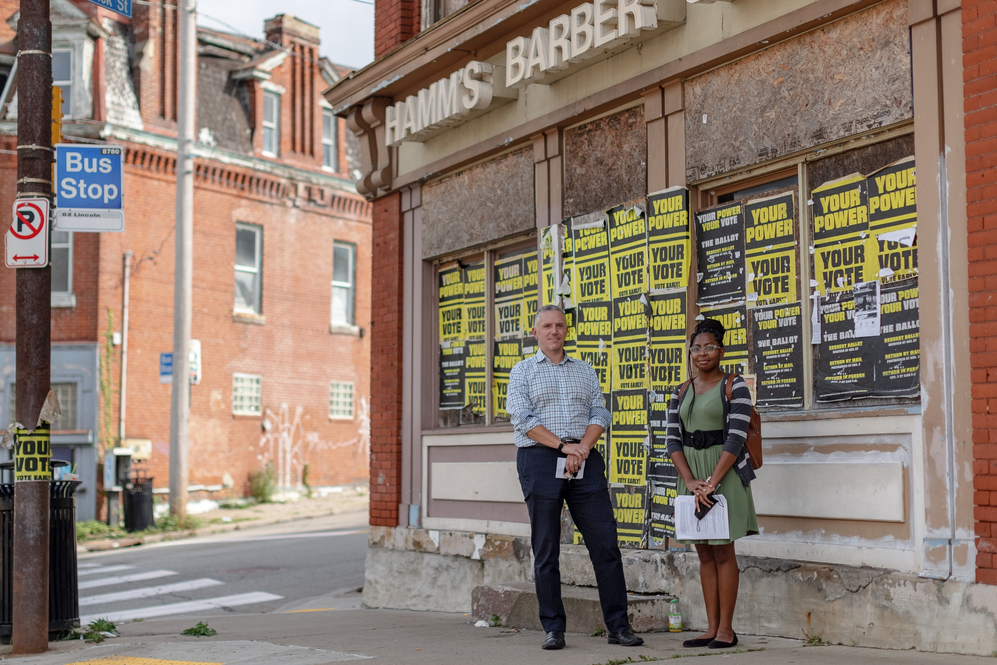 Urban Redevelopment Authority Chief Strategy Officer Tom Link (left) and Community Development Manager Laya Mathews cite the pending redevelopment of the former Hamm's Barber Shop – slated to become Big Tom's Barber Shop and four units of upstairs housing – as an example of a project that has already benefitted from funding attracted as a result of the Avenues of Hope initiative. (Photo by Quinn Glabicki/PublicSource)