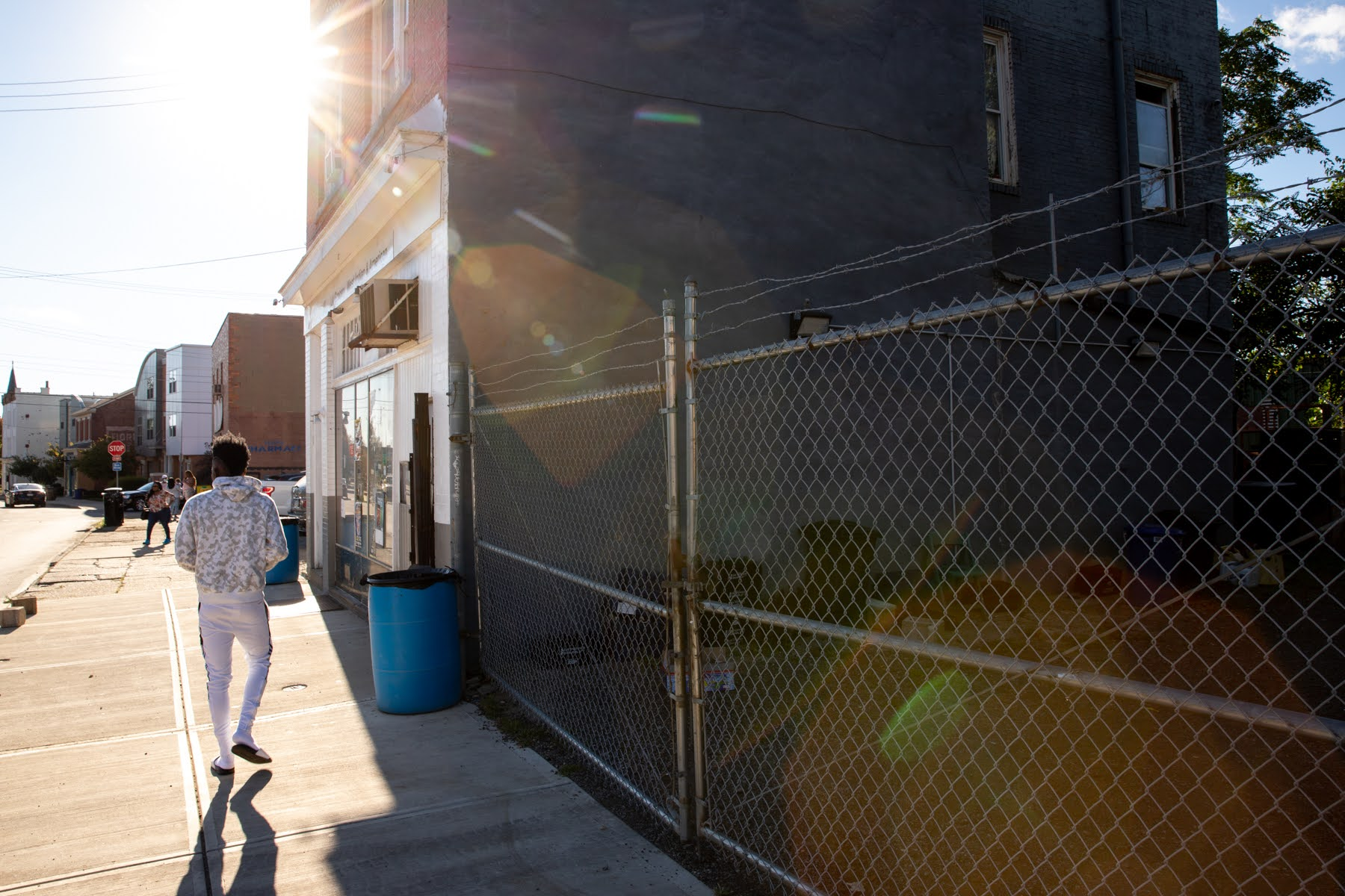 LA Grocery, on Larimer Avenue, and the fenced-in lot next to it, could be beneficiaries of the Avenues of Hope initiative to revitalize seven commercial districts in mostly Black neighborhoods. (Photo by Kaycee Orwig/PublicSource)